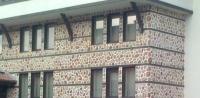 Облицовка на къща от камъни