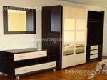 Проекти за обзавеждане за спалня - нестандартен гардероб с класически цветове